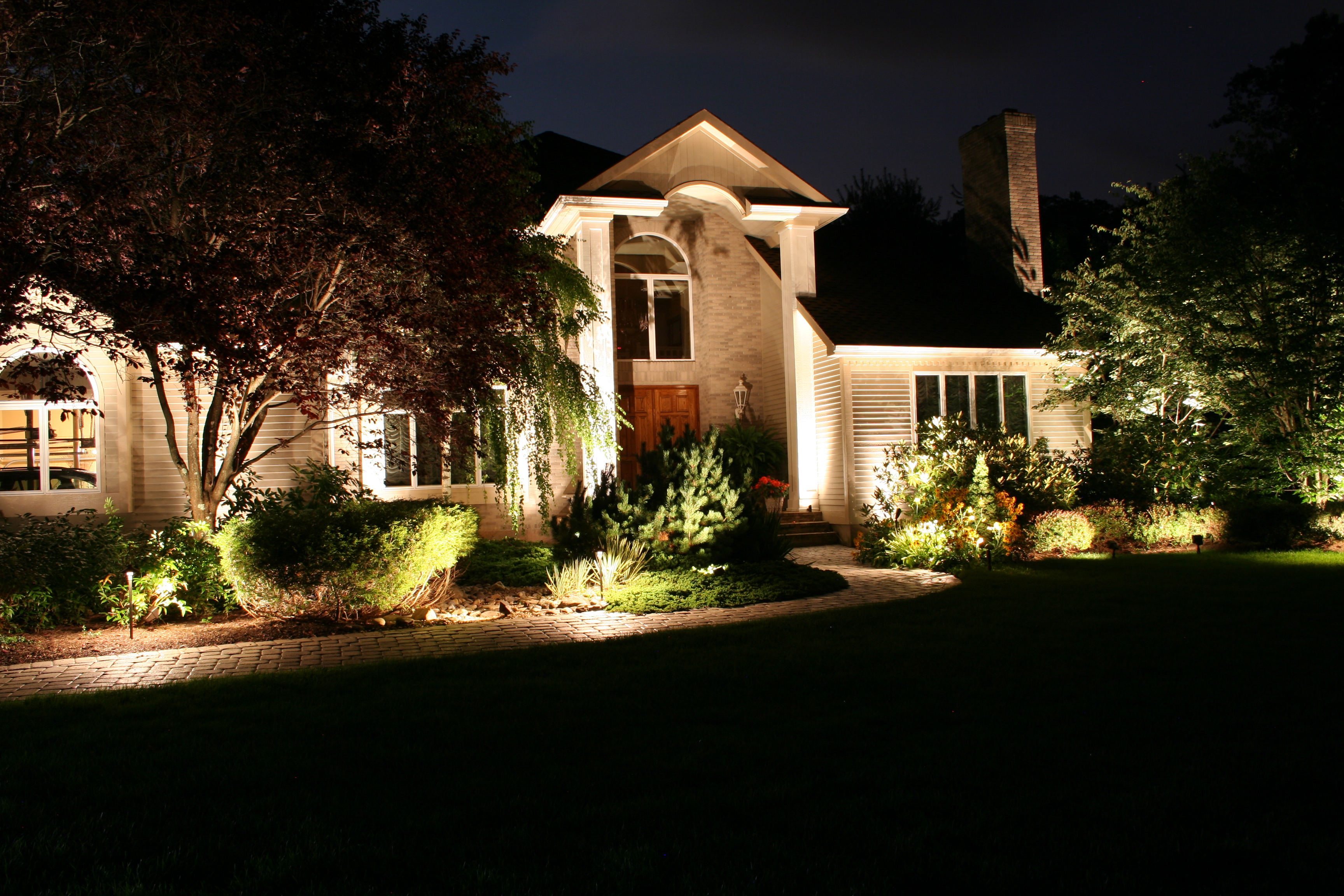 Preferred properties landscape lighting designer shows us for Garden lighting designs