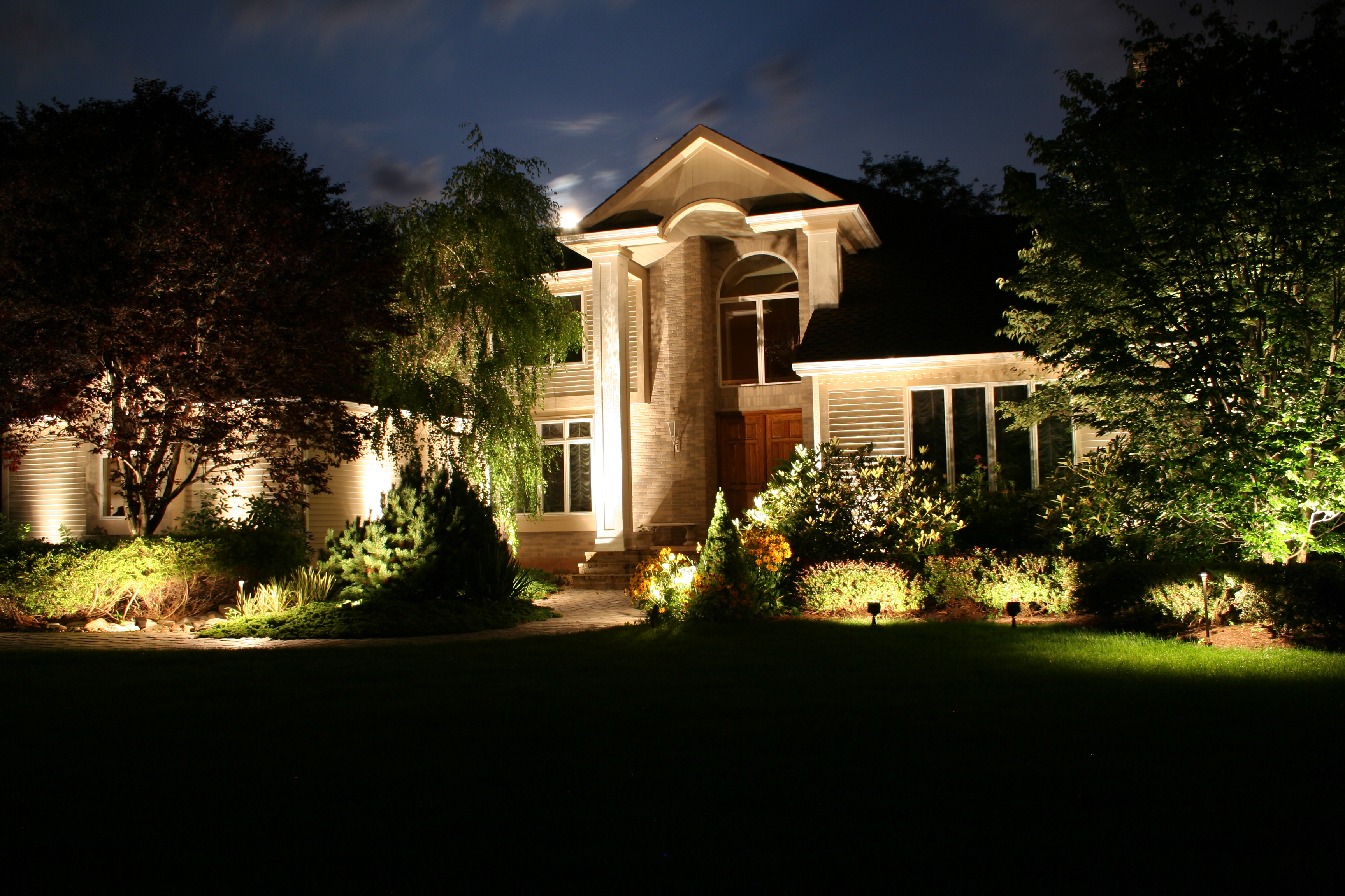Preferred properties landscape lighting designer shows us for Luxury exterior lighting