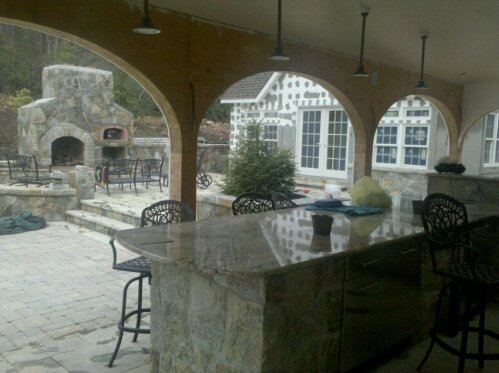 Preferred Properties Landscaping Masonry Applying Stucco And Stone Siding To The Poolhouse And