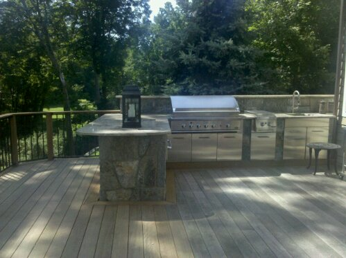Preferred Properties landscaping builds this Outdoor kitchen on the second floor. Elevated outdoor kitchen and stone fireplace with pizza oven. (6/6)