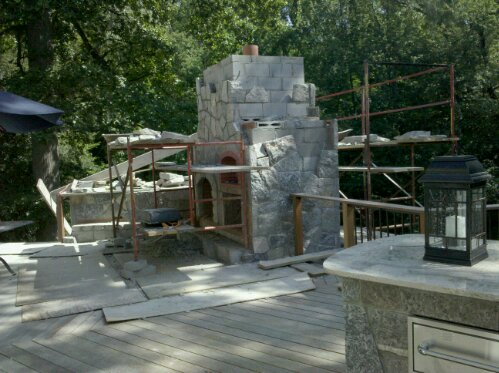 Preferred Properties landscaping builds this Outdoor kitchen on the second floor. Elevated outdoor kitchen and stone fireplace with pizza oven. (4/6)