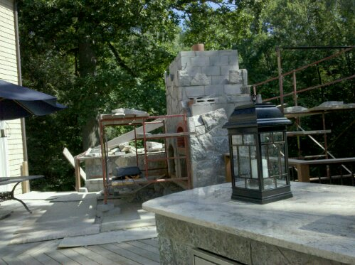 Preferred Properties landscaping builds this Outdoor kitchen on the second floor. Elevated outdoor kitchen and stone fireplace with pizza oven. (3/6)