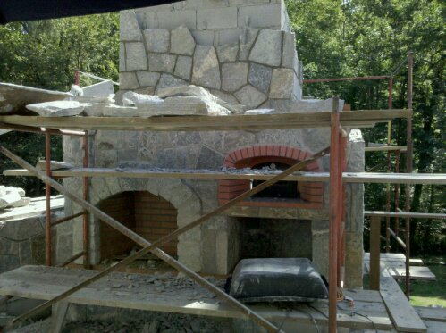 Preferred Properties landscaping builds this Outdoor kitchen on the second floor. Elevated outdoor kitchen and stone fireplace with pizza oven. (1/6)