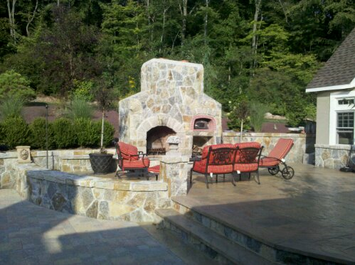 Hgtv Ready Outdoor living project shown is one of the best Poolscapes including covered outdoor kitchen, stone fireplace with pizza oven, stone spa, granite splash deck, sound, lights and more. This award winning project features an incredible Outdoor covered kitchen complete with all the accoutrements one could ever wish for. Flanking this tremendous featured project is an outdoor fireplace with pizza oven.  (4/6)