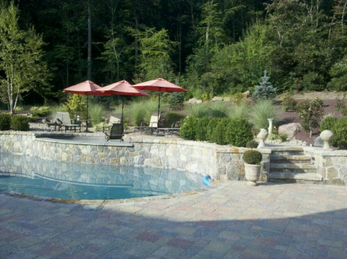 Hgtv Ready Outdoor living project shown is one of the best Poolscapes including covered outdoor kitchen, stone fireplace with pizza oven, stone spa, granite splash deck, sound, lights and more. This award winning project features an incredible Outdoor covered kitchen complete with all the accoutrements one could ever wish for. Flanking this tremendous featured project is an outdoor fireplace with pizza oven.  (1/6)