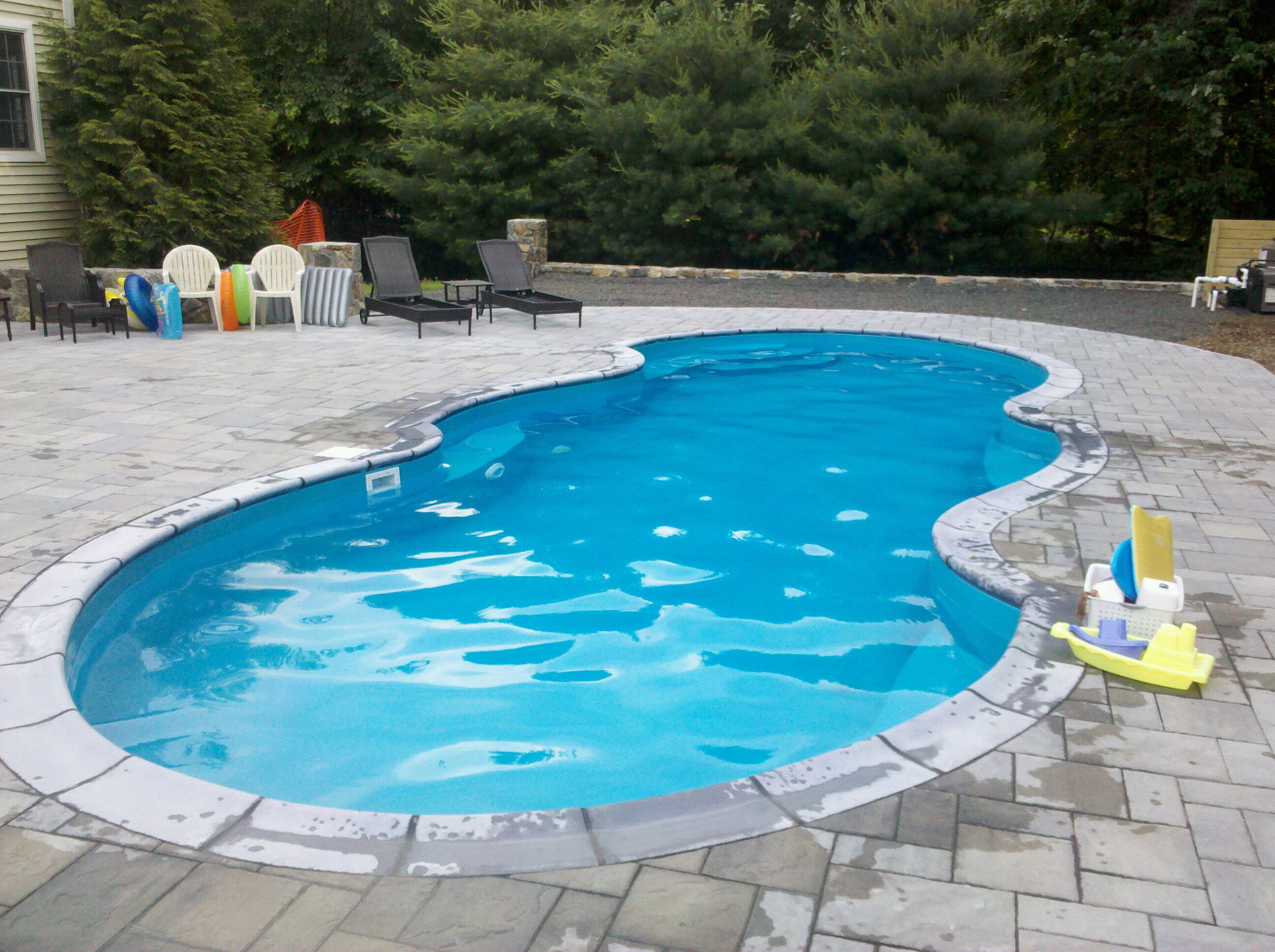 Preferred properties installs this oasis shaped fiberglass for Pictures of a pool