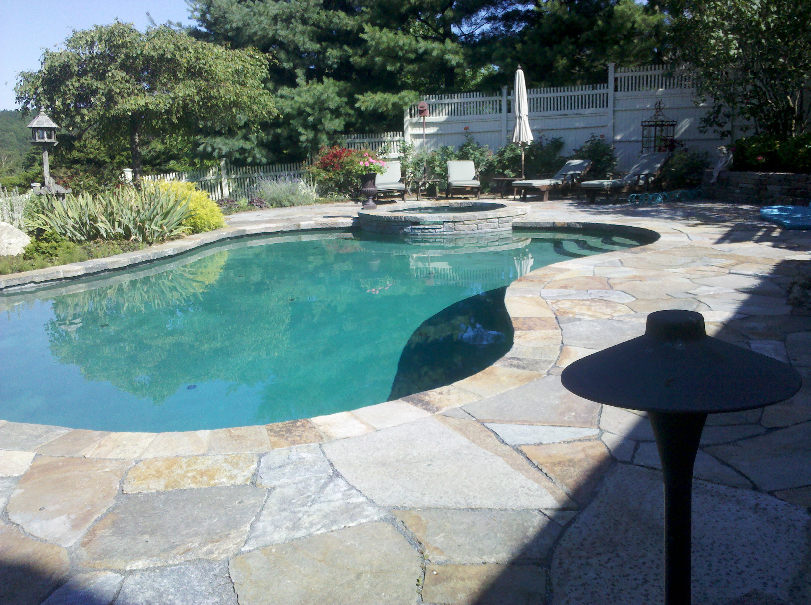 Stone masonry repair needed on this pool deck and patio Masonry