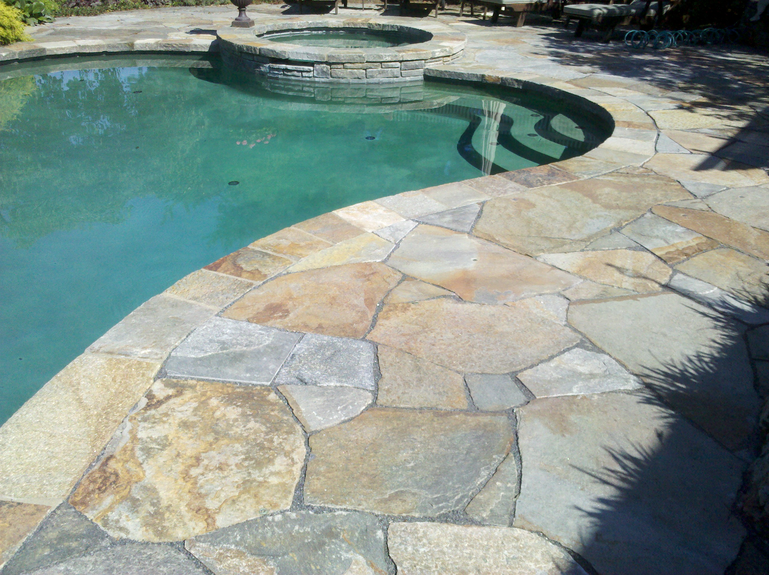 Swimming Pool Stone Sealer : Stone masonry repair needed on this pool deck and patio