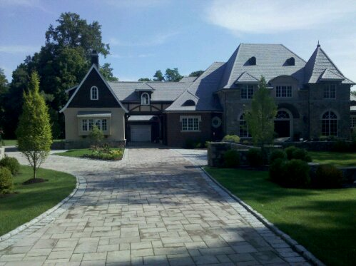 Outdoor living designer Michael Gotowala of Preferred Properties Landscaping and Masonry combines his vision and all his crews talents in directing them to complete this extraordinary landscape anchoring this residence in Fairfield county Connecticut. (2/4)