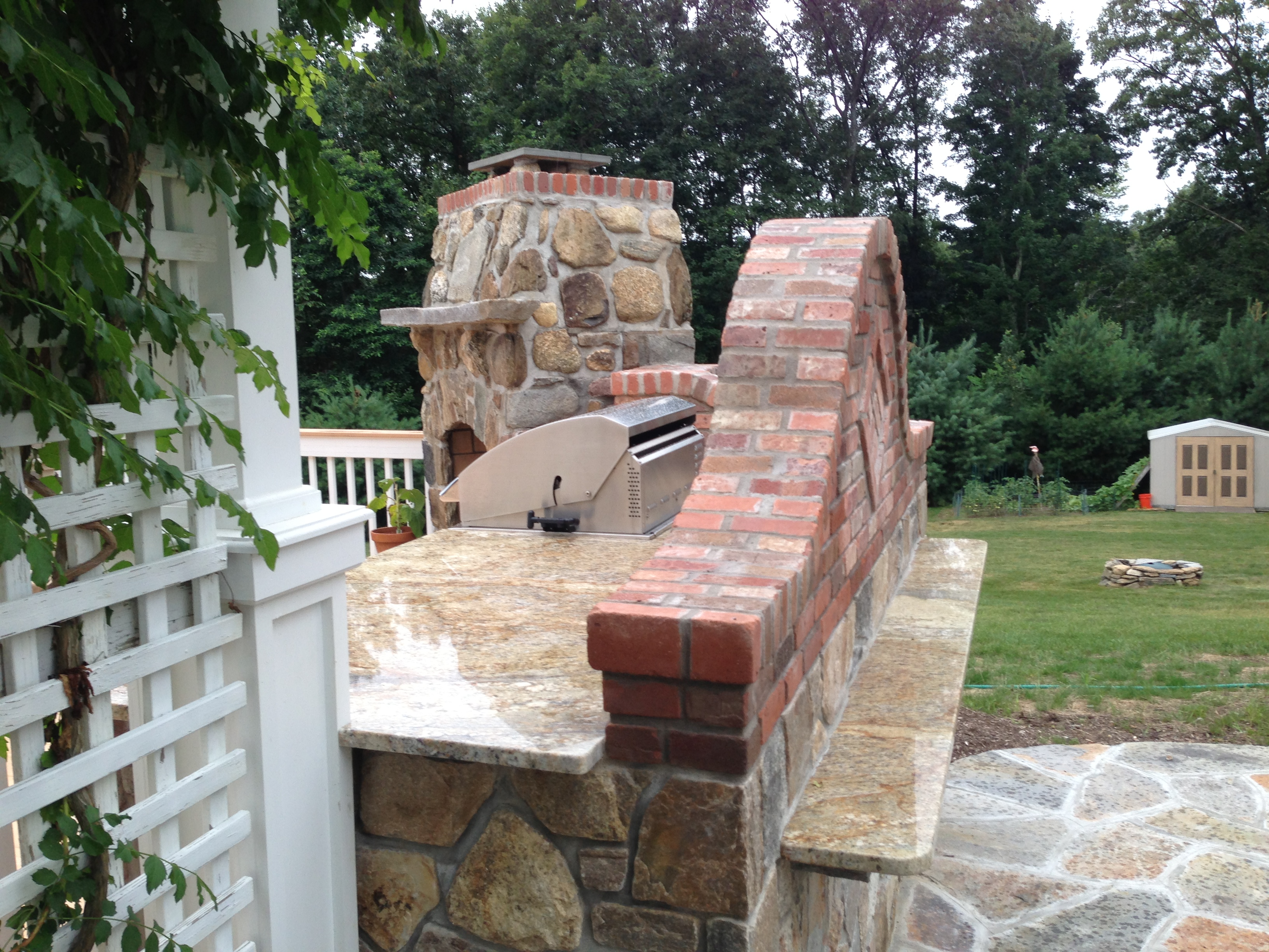 The Blending Of The Brick And Stone Are Brought To The Top With The Yellow  River Granite Which Also Pulls The Yellow Stone From The Fireplace.