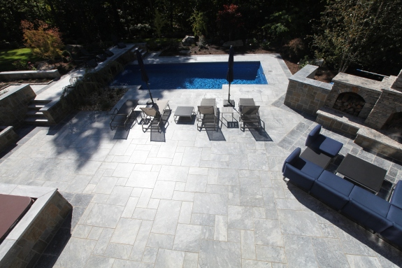 Outdoor marble patio with surround of antiqued polished marble to texturize the patio. Some of which the Marble is heated from underneath.