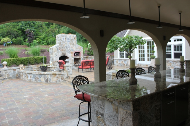 The more dramatic the outdoor fireplace appears, the more dramatic the outdoor living space.