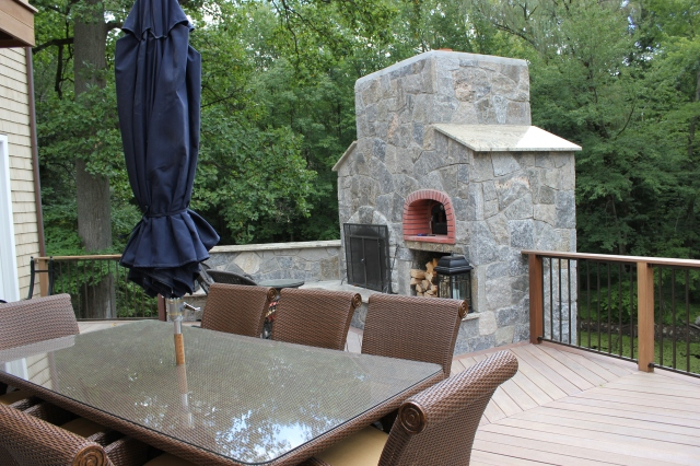 The Outdoor fireplace is the central hub to linking the outdoor kitchen to the outdoor living space. For more outdoor Kitchen fabulous ideas go to THE OUTDOOR KITCHEN DESIGN STORE. www.OutdoorKitchenDesigner.com