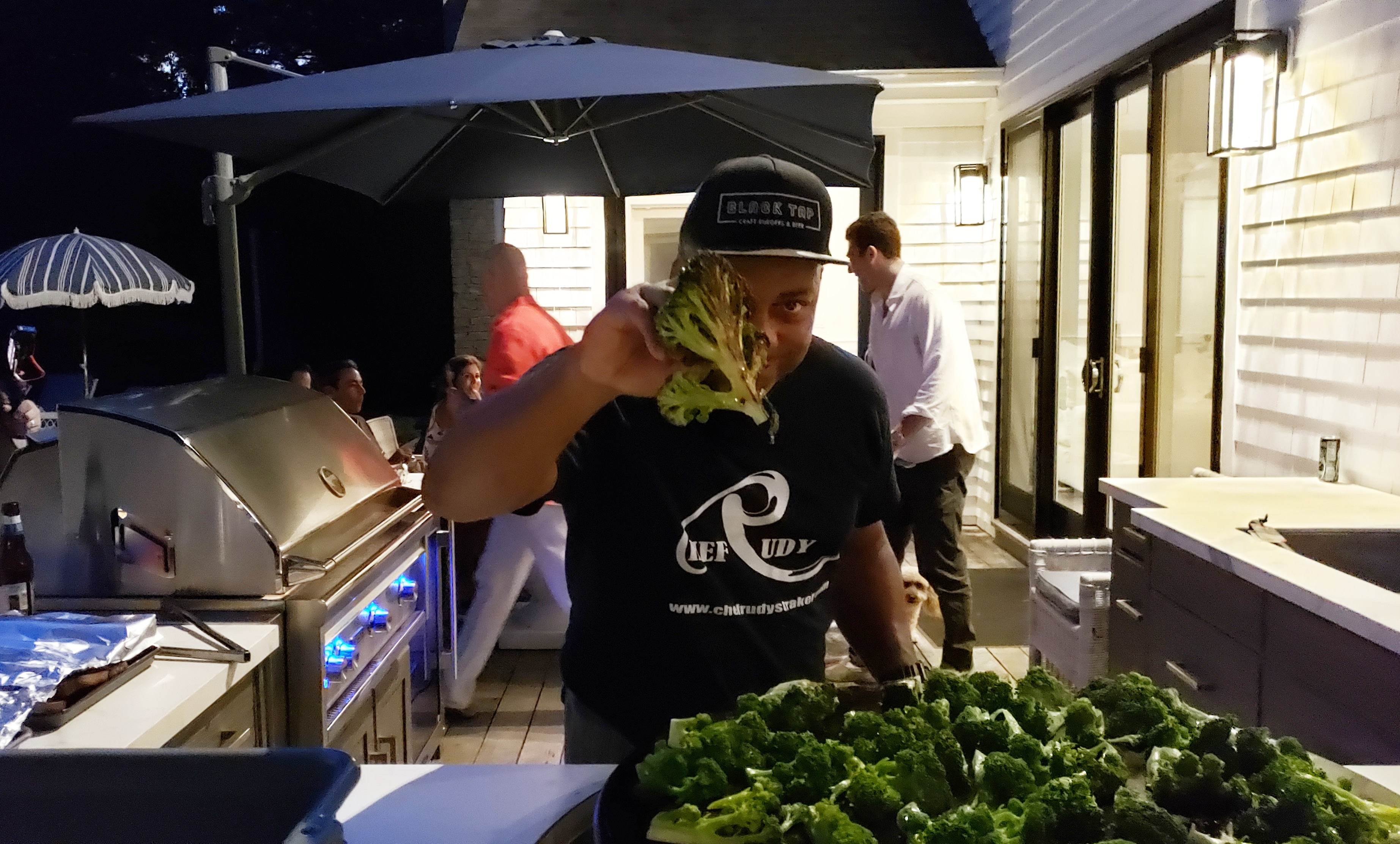 Chef Rudy cooking burnt garlic broccoli on the EVO grill