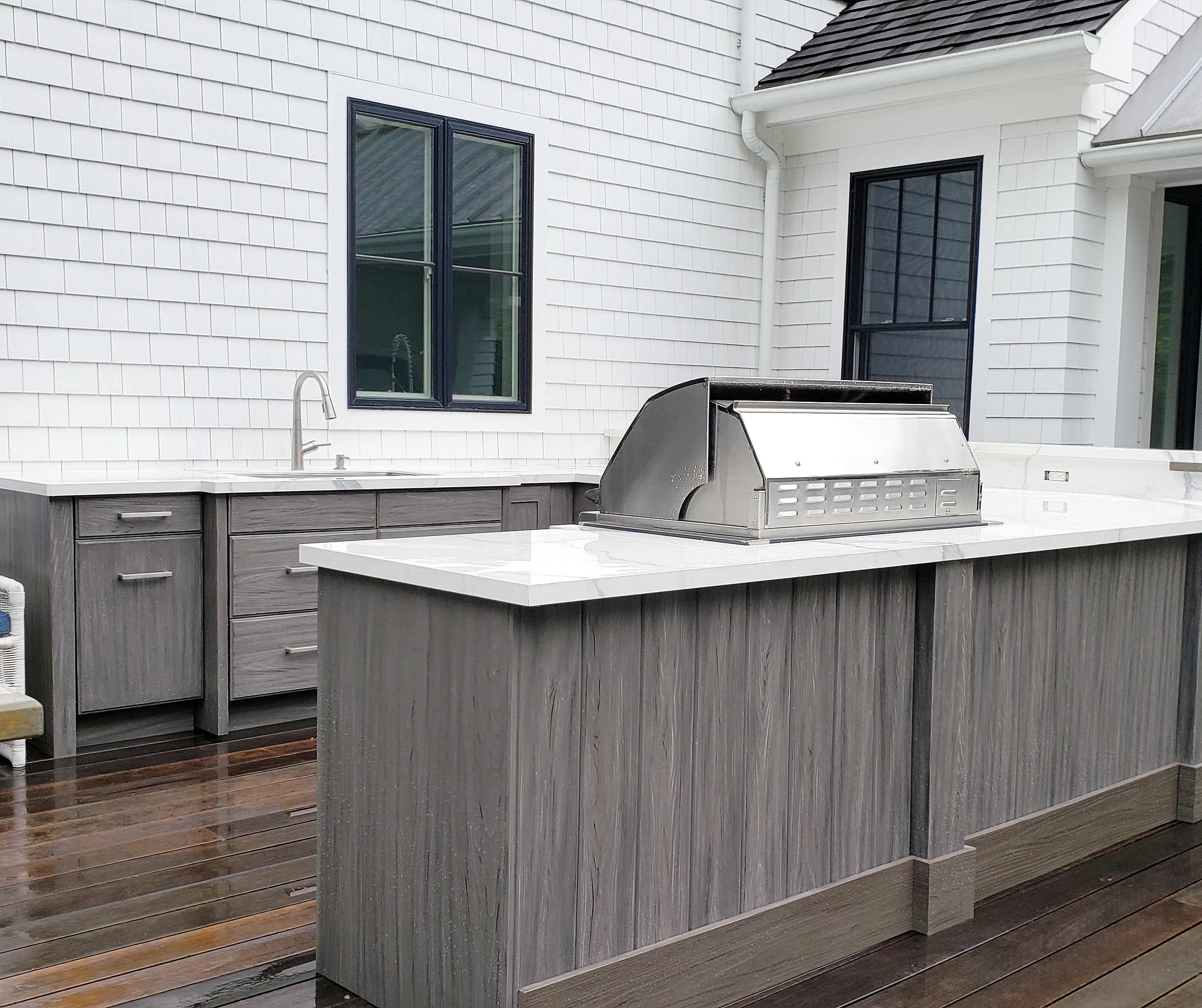 The U shaped Outdoor Kitchen works well for family and friends.